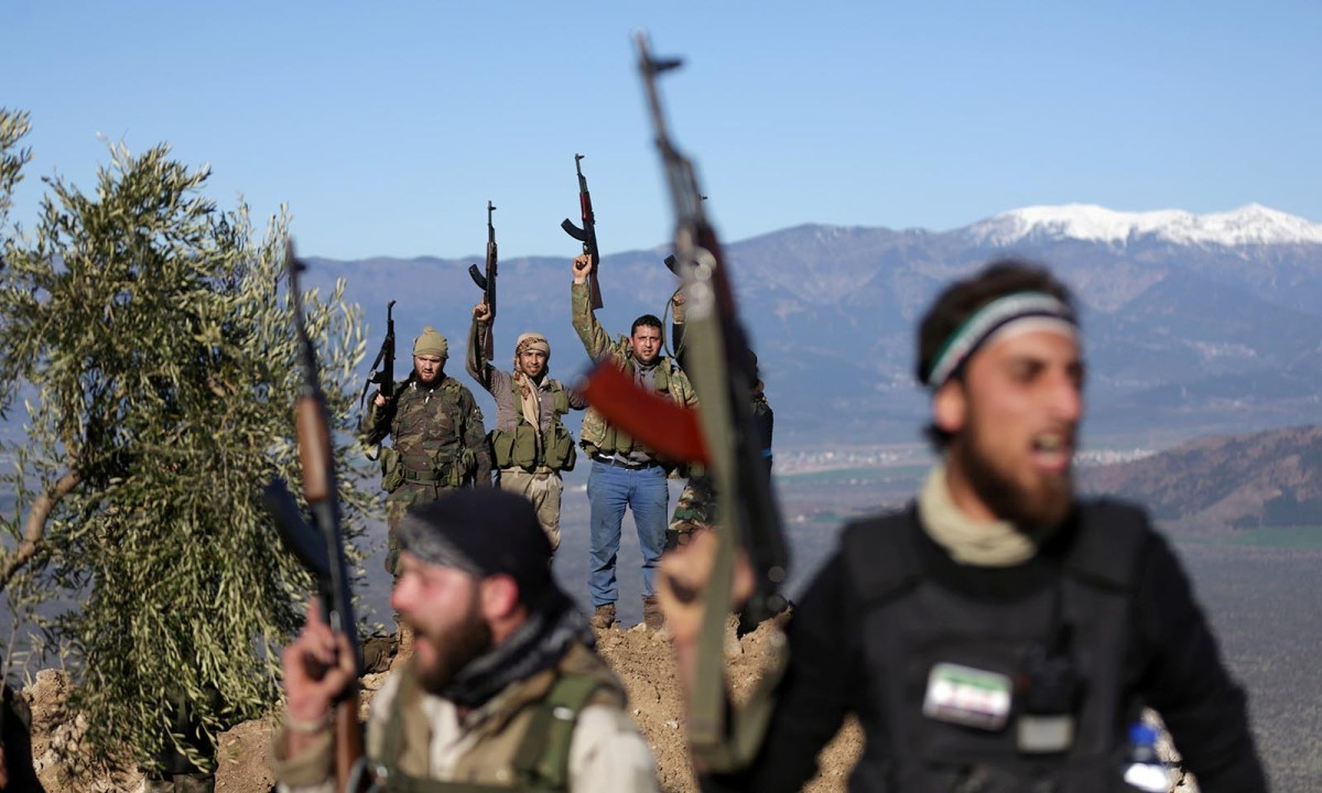 Turkish-backed Free Syrian Army fighters near the city of Afrin, Syria on February 19, 2018. Photo: Reuters/Khalil Ashawi