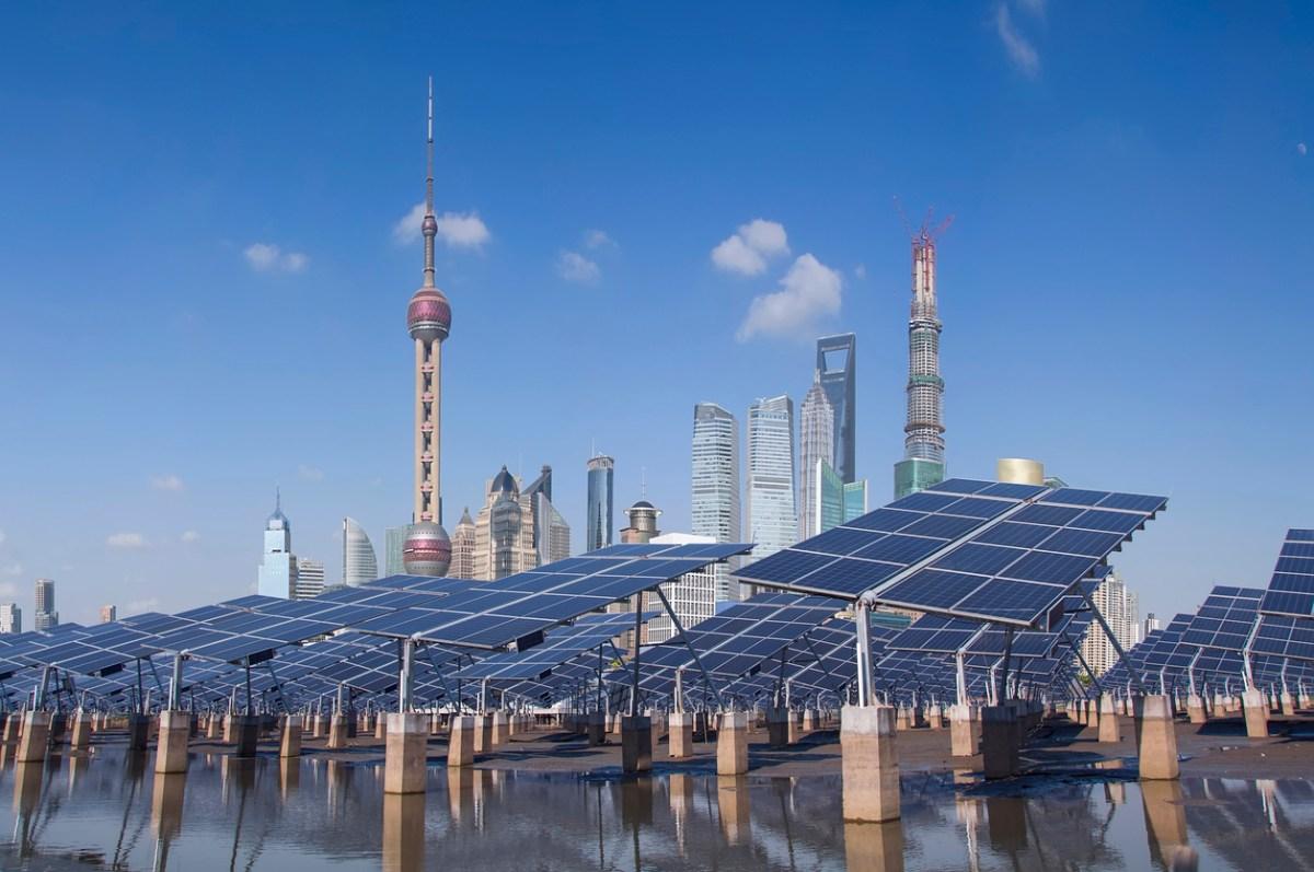 Shanghai Bund skyline landmark, Ecological energy renewable solar panel plant. Photo: iStock