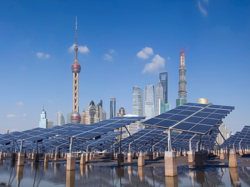 Shanghai Bund skyline landmark, Ecological energy renewable solar panel plant. Photo: iStock