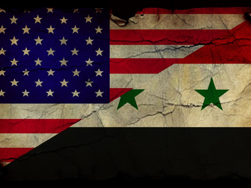USA and Syrian flag in grunge and vintage style. Photo: iStock