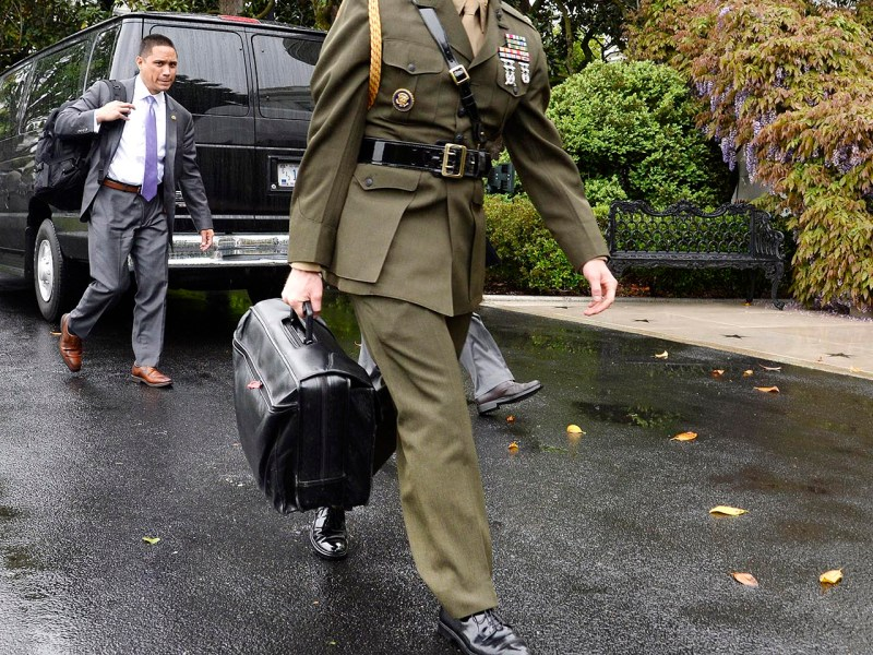 "A US military aide carries the ""nuclear football.""  Photo: AFP / Olivier Douliery / Pool via CNP"