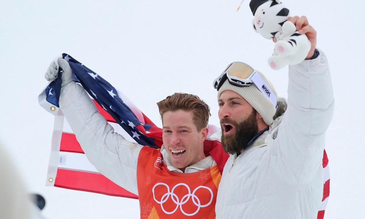Men's Snowboarding Halfpipe Gold medallist Shaun White celebrates with coach JJ Thomas. Photo: Reuters / Mike Blake