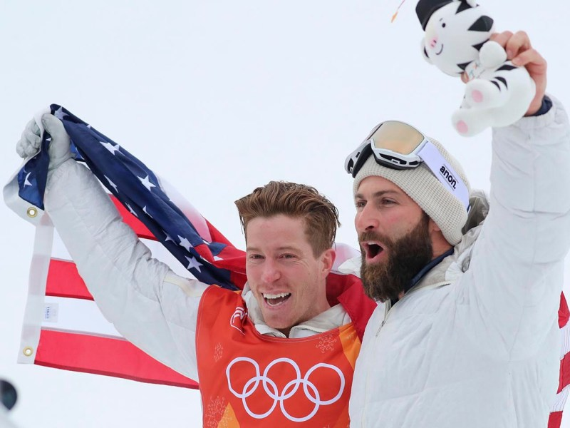 Men's Snowboarding Halfpipe Gold medallist Shaun White celebrates with coach JJ Thomas. Photo: Reuters / Mike Blake