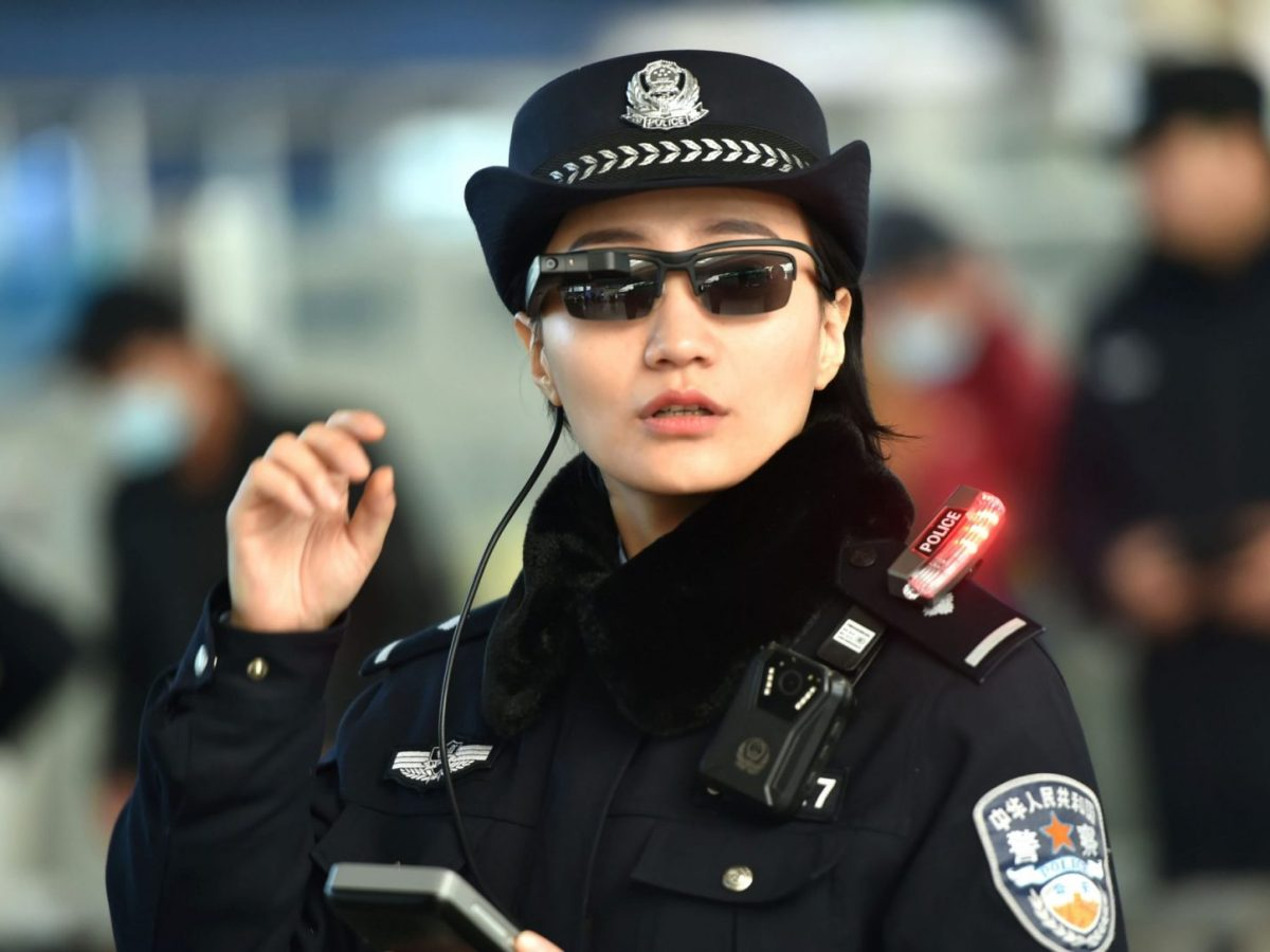 A Chinese police officer wears a pair of facial-recognition smart glasses at Zhengzhou East Railway Station in Zhengzhou in China's central Henan province. Photo: AFP