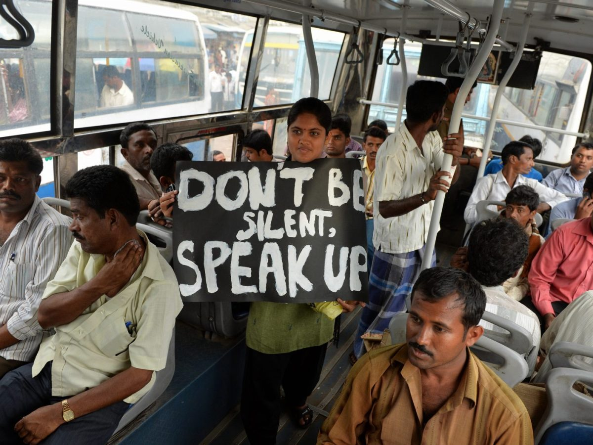 An Indian protester holds a placard against the sexual harassment of female passengers, in a Bangalore Metropolitan Transport Corporation bus in Bangalore, India, on October 7, 2013.  Photo: AFP/Manjunath Kiran