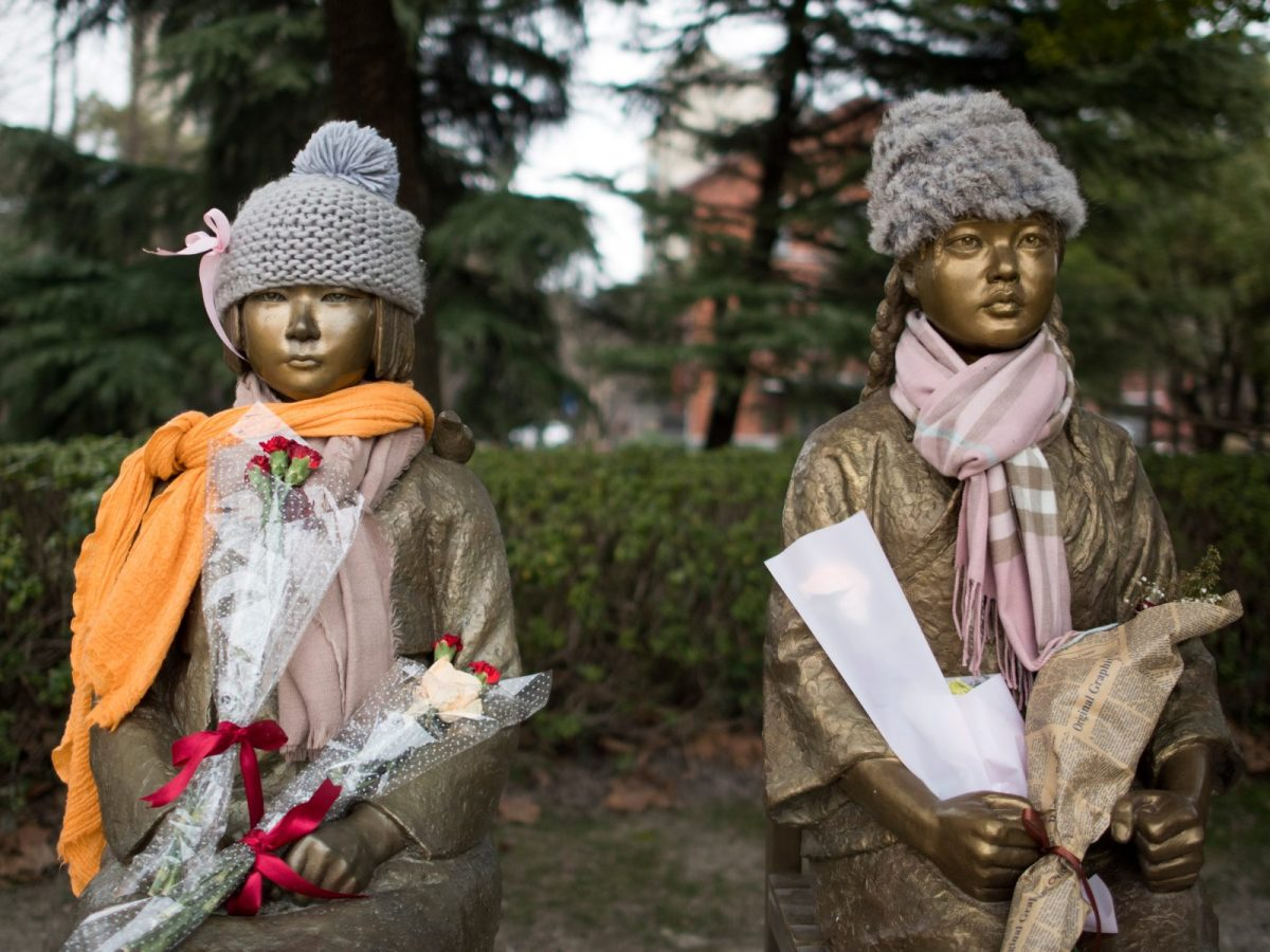 "This picture taken on February 1, 2017 shows statues symbolizing so-called ""comfort women"" in a park in Shanghai. Photo: AFP / Johannes Eisele"