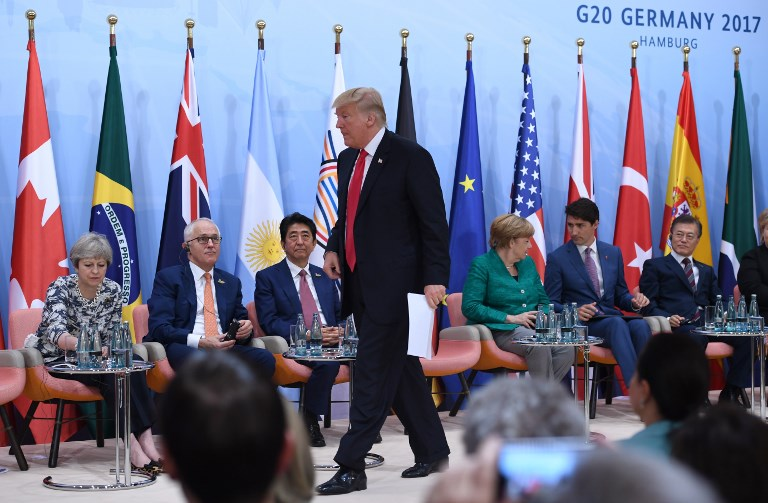 US President Donald Trump prepares to give a speech during a panel discussion during the G20 Summit in Hamburg last July. Photo: Reuters/Patrik Stollarz