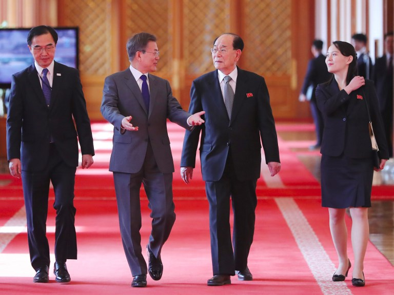 South Korea's President Moon Jae-in (second left) walks with North Korean leader Kim Jong Un's sister Kim Yo-jong (right) and North Korea's nominal head of state, Kim Yong-nam, in February. Photo: Yonhap via AFP