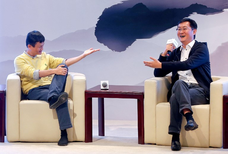 Pony Ma Huateng (right), chairman and CEO of Tencent, speaks next to Jack Ma, chairman of Alibaba Group. Photo: AFP