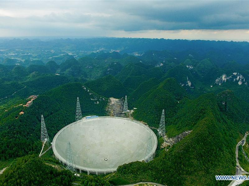 The cutting-edge Five-hundred-meter Aperture Spherical Radio Telescope against a backdrop of lush greenery and rugged terrain in China's Guizhou province. Photo: Xinhua