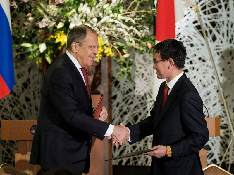 Russian Foreign Minister Sergei Lavrov shakes hands with Japanese Foreign Minister Taro Kono. Photo: Pool via Reuters/Nicolas Datiche