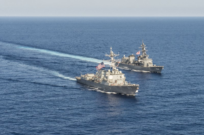 The destroyer USS Mustin transits in formation with Japan Maritime Self-Defense Force ship JS Kirisame  in the South China Sea.  Photo: David Flewellyn/U.S. Navy/Handout via Reuters