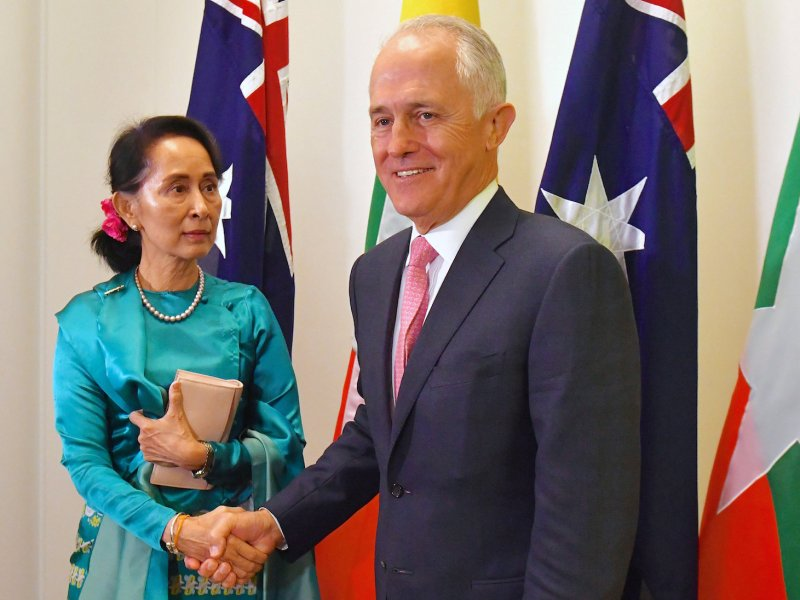Australia's Prime Minister Malcolm Turnbull shakes hands with Myanmar's State Counsellor Aung San Suu Kyi at Parliament House in Canberra, Australia, March 19, 2018.    Photo: AAP via Reuters/Mick Tsikas