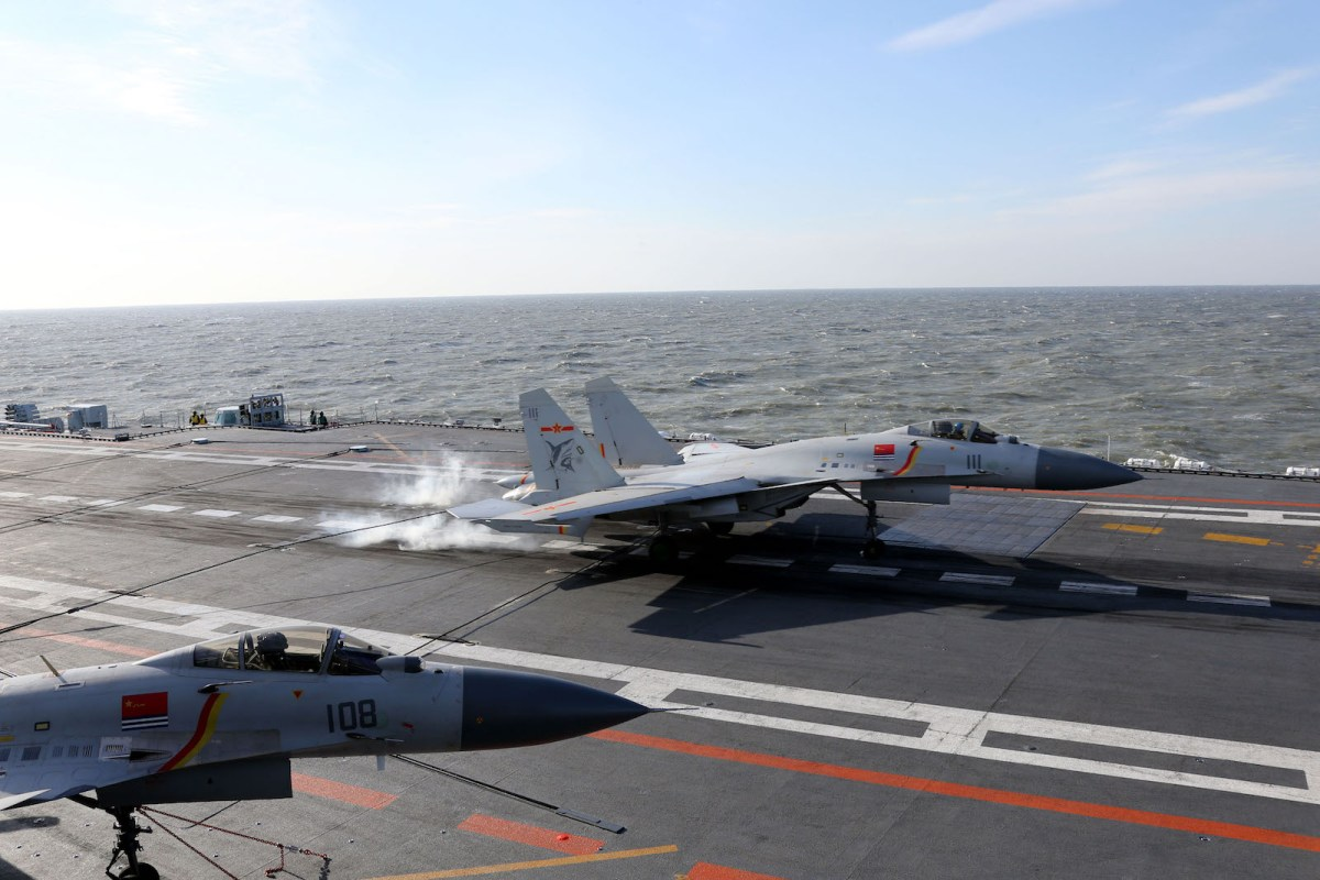A Chinese J-15 fighter jet lands on the deck of the Liaoning aircraft carrier during military drills. Photo: AFP