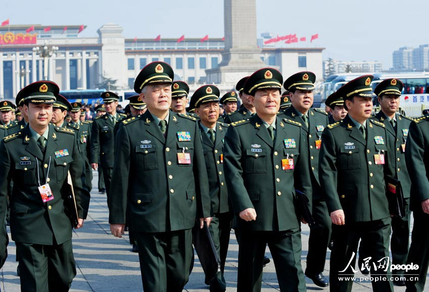 PLA delegates to the National People's Congress are seen in front to the Great Hall of the People in Beijing's Tiananmen Square. Photo: People's Daily