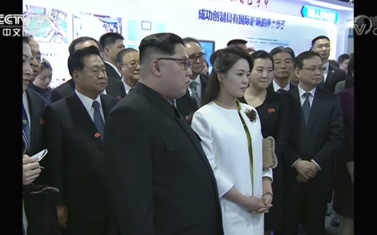 Kim Jong-un and his wife Ri Sol-ju are seen visiting the Beijing-based Chinese Academy of Sciences. Source: China Central Television screen grab