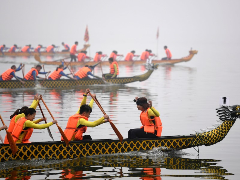 Rowers take part in a dragon boat race in Hanoi, Vietnam on February 24, 2018. Photo: AFP/Nhac Nguyen