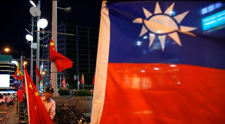 Chinese and Taiwanese flags in Taipei. Photo: Reuters
