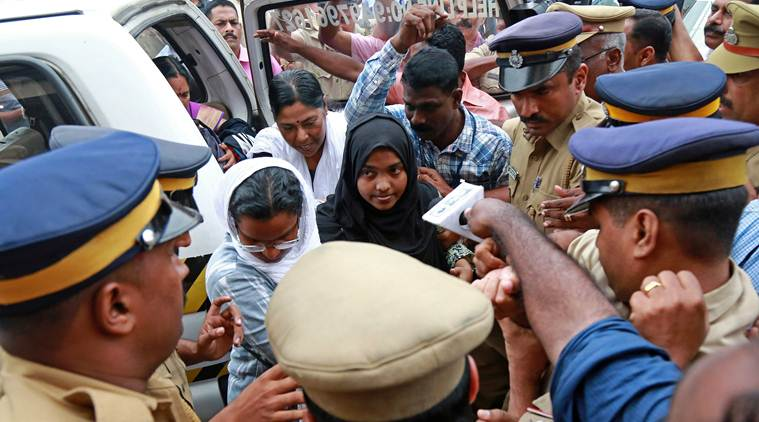 Akhila, 24, who converted to Islam in 2016 and took a new name, Hadiya, arrives at the airport in Kochi, India. Photo: Reuters / Sivaram V