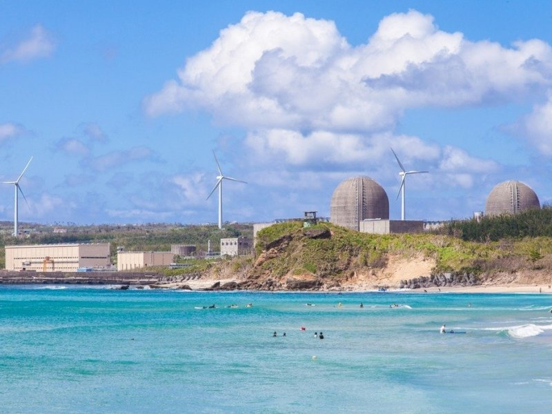 The concrete shields of the Ma-anshan Nuclear Power Plant are visible from a popular beach in southern Taiwan's Pingtung county. Photo: Taipower Co.