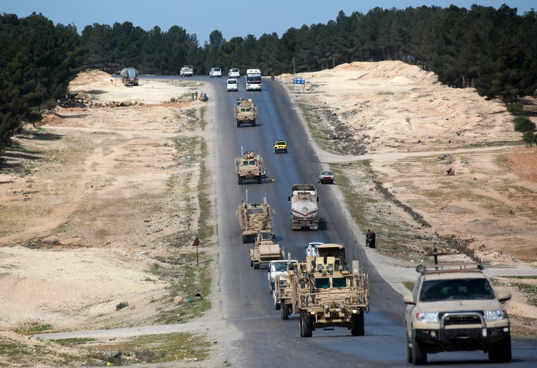 A picture taken on April 3, 2018, shows vehicles of US-backed coalition forces driving in the northern Syrian town of Manbij. Photo: AFP/Delil Souleiman