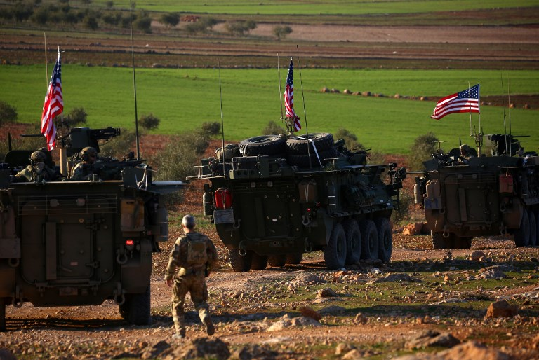 A convoy of US armored vehicles drives near the village of Yalanli, on the western outskirts of the northern Syrian city of Manbij. Photo: AFP/Delil Souleiman