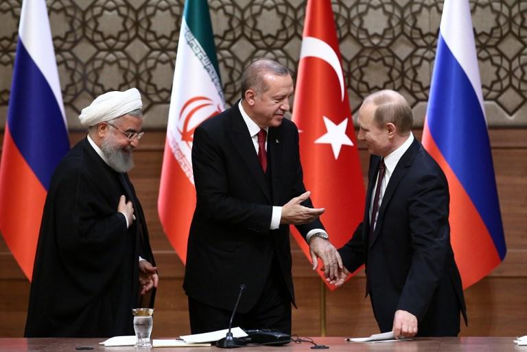 Turkish President Tayyip Erdogan, Russian President Vladimir Putin, and President of Iran, Hassan Rouhani hold a joint press conference following the Turkey-Russia-Iran Tripartite summit in Ankara. Photo: Anadolu Agency via AFP/Rasit Aydogan