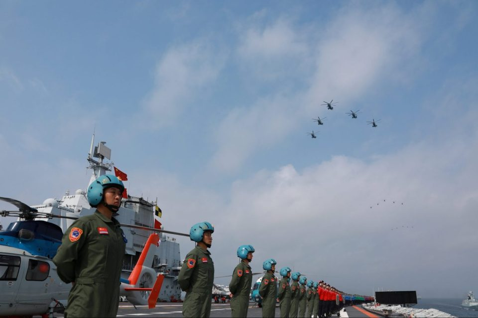 Navy personnel of Chinese People's Liberation Army Navy take part in a military display in the South China Sea April 12, 2018. Photo: Reuters