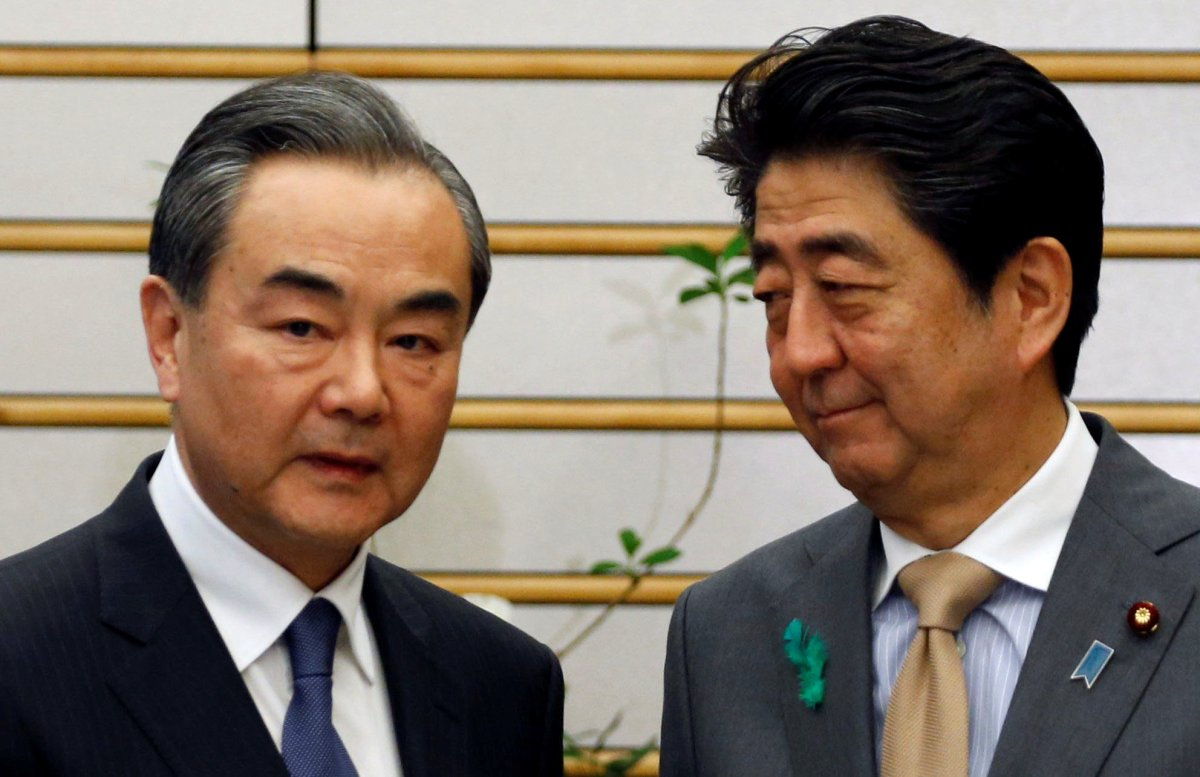 Chinese government's top diplomat, State Councillor Wang Yi meets with Japan's Prime Minister Shinzo Abe at Abe's official residence in Tokyo. Photo: Reuters/Toru Hanai
