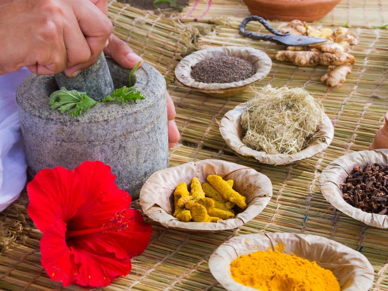 Ayurvedic medicine is prepared in the traditional manner in India. Photo: iStock