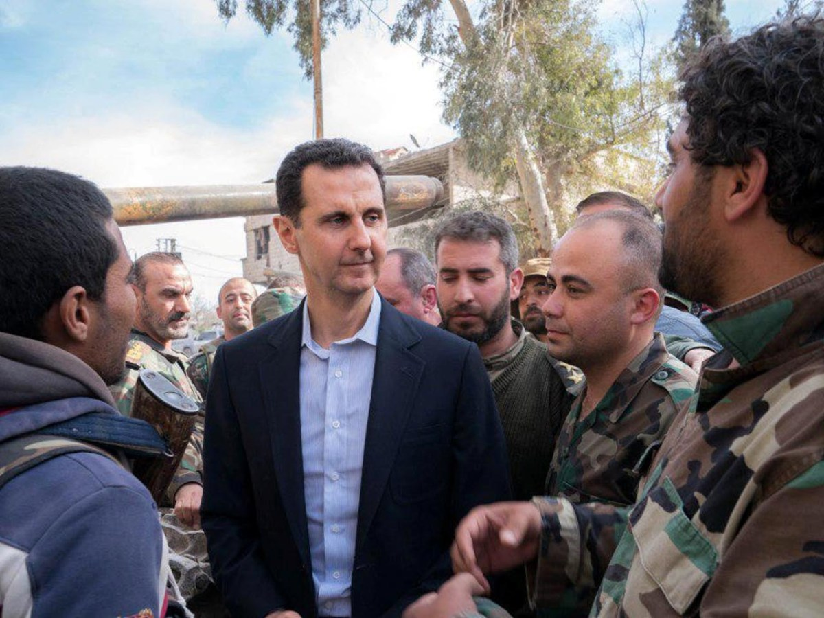 Syrian President Bashar al-Assad meets Syrian troops in eastern Ghouta on March 18, 2018. Photo: Sana handout via Reuters