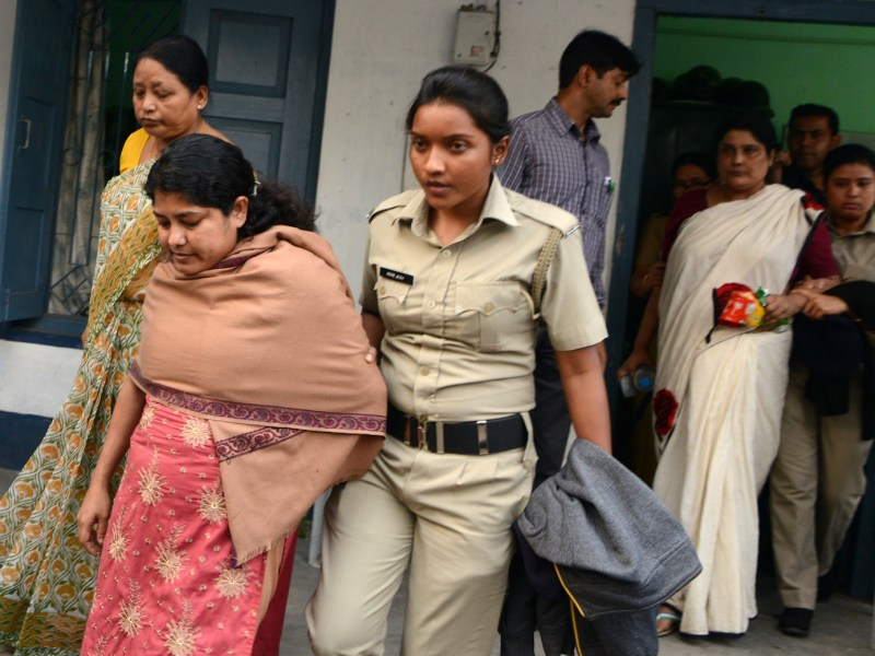 Indian police escort suspects in Jalpaiguri in February 2017 for a medical checkup in West Bengal after their arrest over a child trafficking scandal. Photo: AFP/Diptendu Dutta