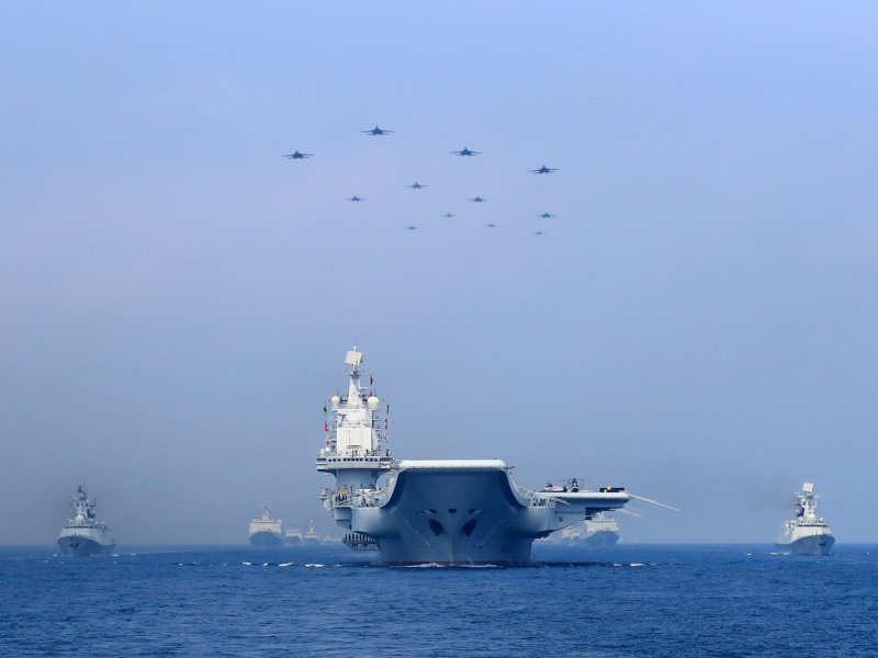 Warships and fighter jets of Chinese People's Liberation Army (PLA) Navy take part in a military display in the South China Sea on April 12, 2018. Photo: Reuters