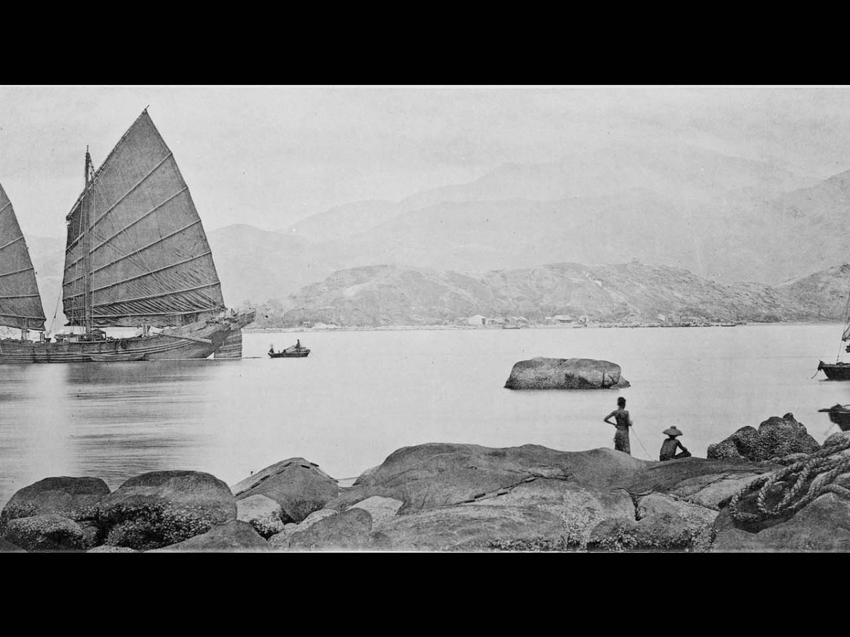 A Junk in Guangzhou harbour in 1869-71. According to Thomson the vessel shown here 'is a fine type of its class and has in her model something of the foreign ship, though retaining quite enough of the old Chinese build to soothe the prejudices of the nation.'