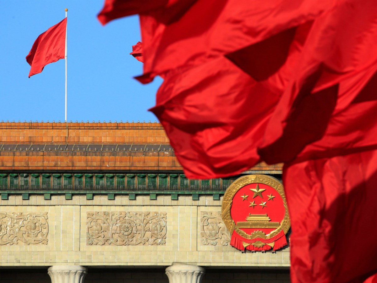 Red flags flutter outside the Great Hall of the People before the second plenary session of the Chinese People's Political Consultative Conference (CPPCC) in Beijing, China March 8, 2018. Photo: Reuters/Aly Song