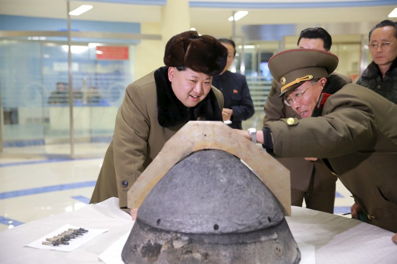 Kim Jong-un looks at a rocket warhead tip after a simulated test of atmospheric re-entry of a ballistic missile, at an unidentified location in this undated photo released March 15, 2016. Photo: Reuters/KCNA