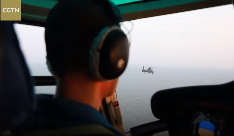 A PLA airman in the cockpit of an assault helicopter during Wednesday's drill. Photo: CGTN screen grab