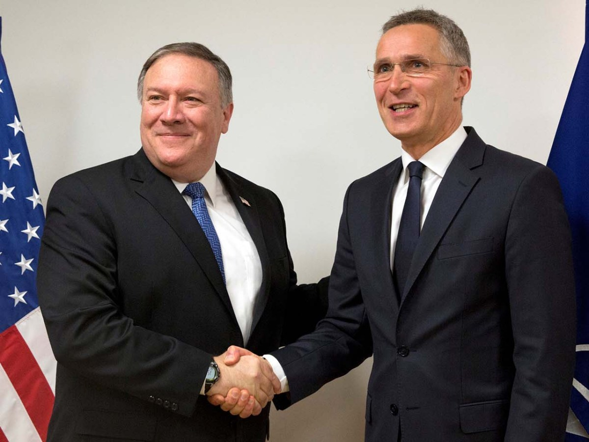 US Secretary of State Mike Pompeo is welcomed by NATO Secretary General Jens Stoltenberg at a NATO foreign ministers meeting at the Alliance's headquarters in Brussels on April 27, 2018. Photo: Pool via Reuters