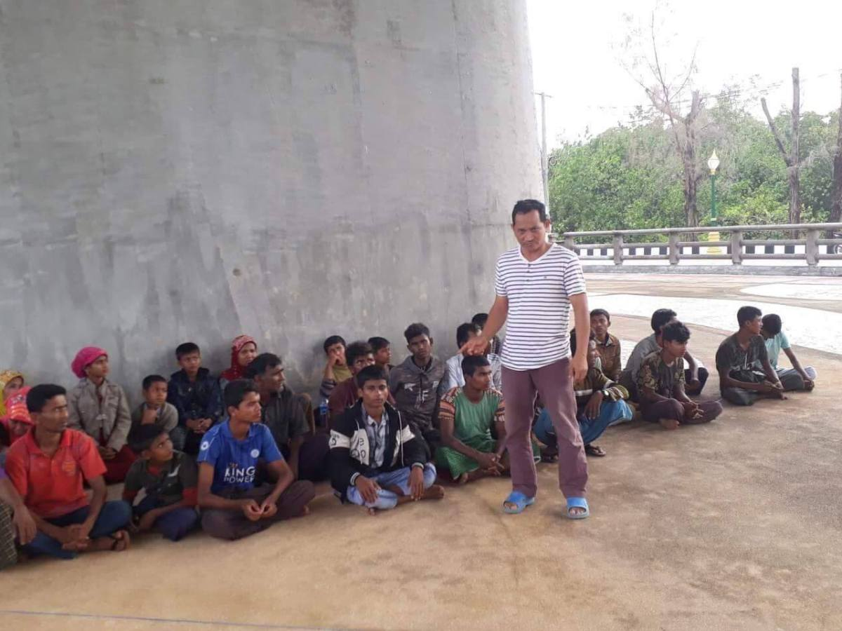 'Rohingya' are guarded in Krabi province while their boat was repaired and 'allowed' to continue its voyage to Malaysia. Photo: Facebook/ Alan Morison