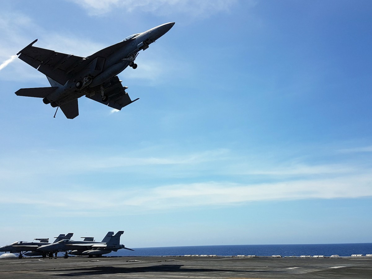 An F18 fighter takes off from the deck of the USS Theodore Roosevelt while transiting the South China Sea, April 10, 2018. Photo: Reuters/Karen Lema