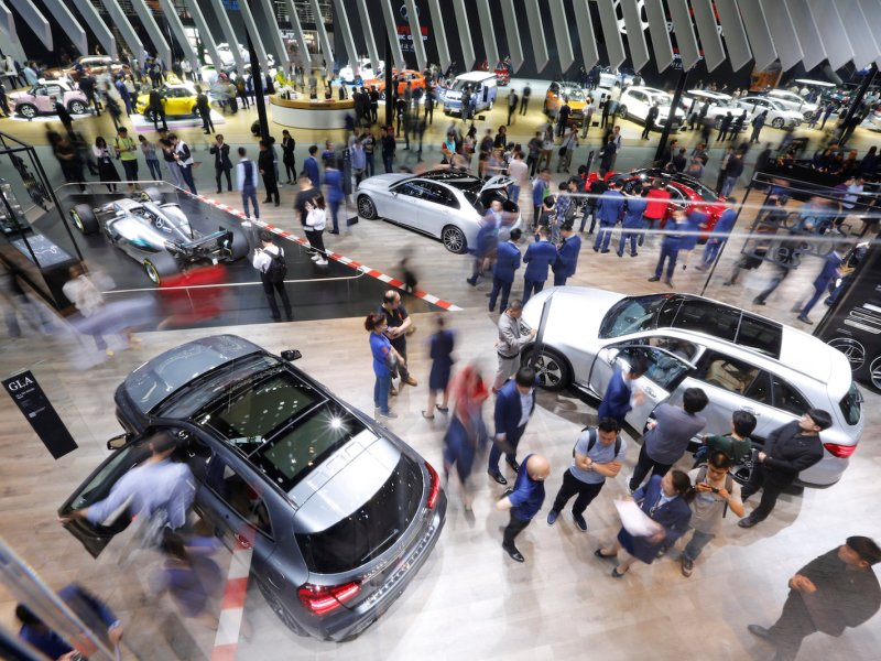 People visit the Mercedes-Benz booth during the Auto China 2018 motor show in Beijing on April 26, 2018.  There are fears that the country's debt-funded consumption is unsustainable. Photo: Reuters / Jason Lee