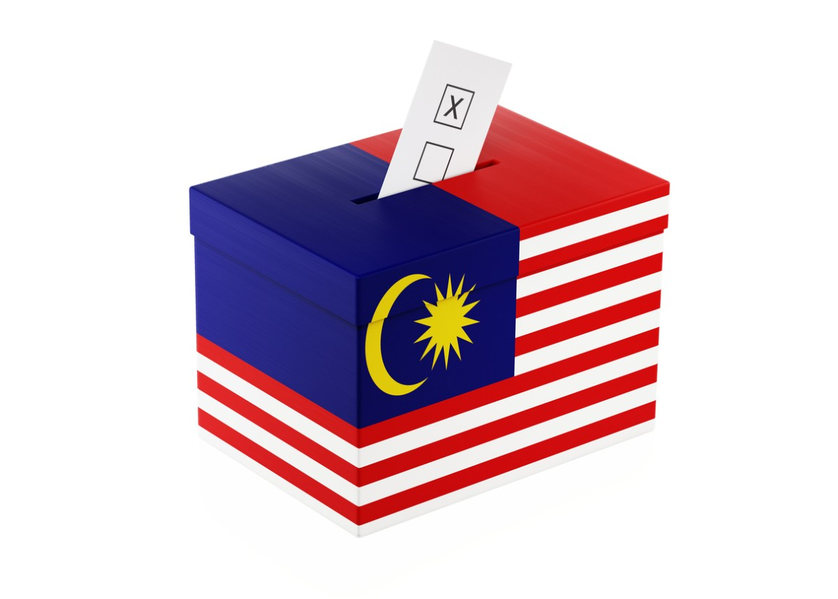 Ballot box textured with  Malaysian Flag. Isolated on white background. A vote envelope is entering into the ballot box. Horizontal composition with copy space. Great use for referendum and 2018 presidential elections related concepts. Clipping path is included. Photo: iStock