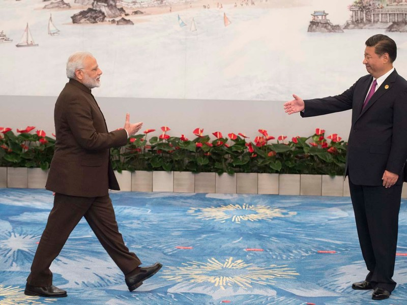 Chinese President Xi Jinping welcomes Indian Prime Minister Narendra Modi during the BRICS Summit in Xiamen on September 4, 2017. Photo: AFP/Fred Dufour