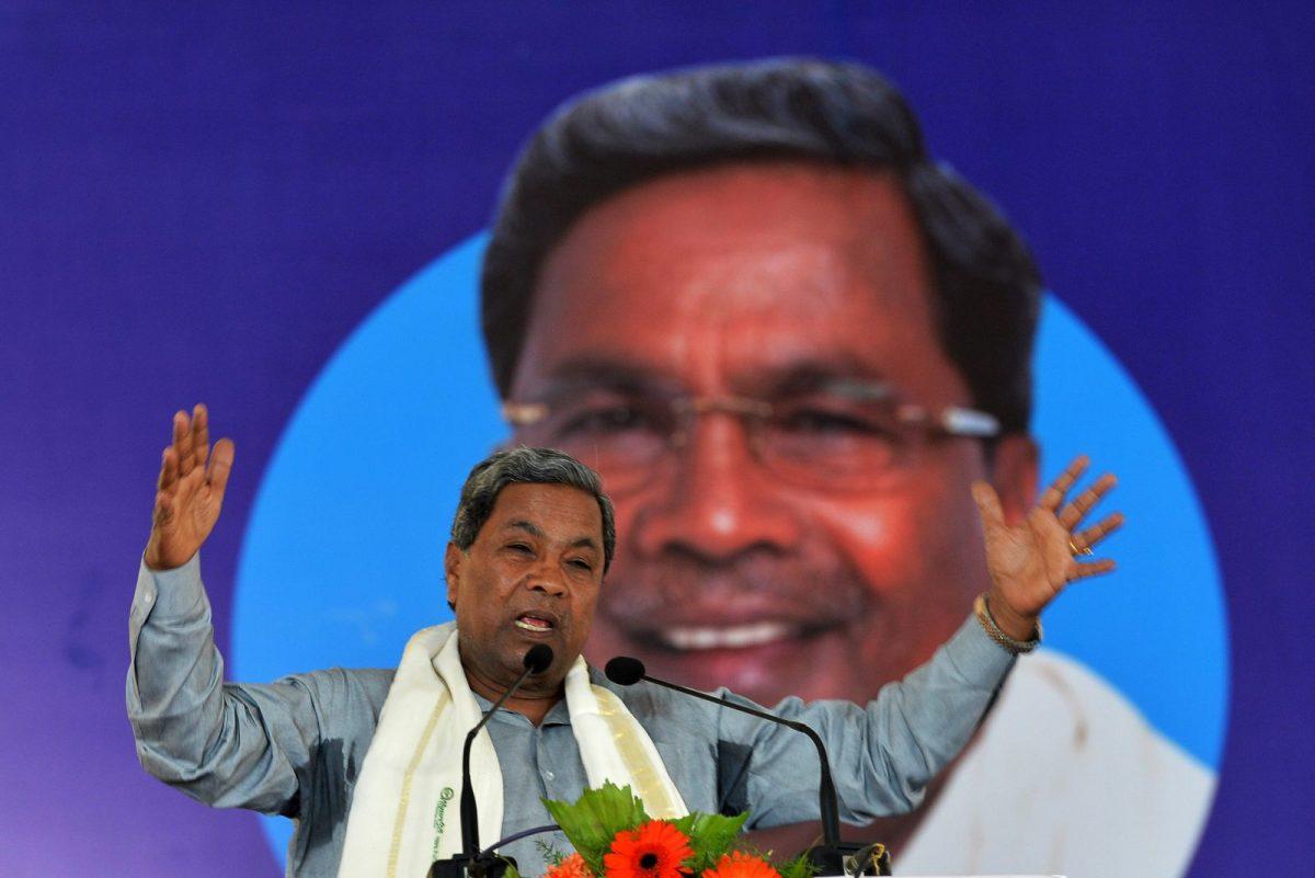 Karnataka Chief Minister Siddaramaiah gestures while addressing a gathering during the inauguration of a 2000-megawatt solar power park. Photo: AFP/ Manjunath Kiran
