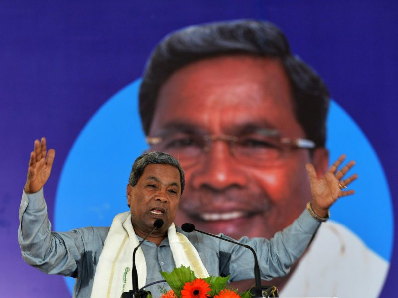 Karnataka Chief Minister Siddaramaiah gestures while addressing a gathering during the inauguration of a 2000-megawatt solar power park. Photo: AFP/ Manjunath Kiran