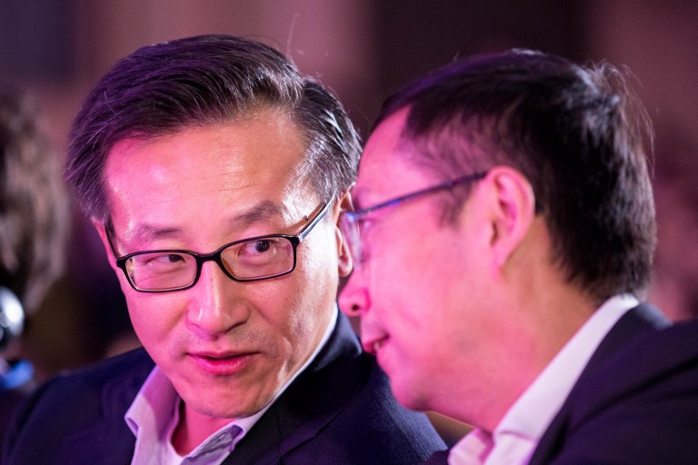 Joseph Tsai (left), co-founder and executive vice-chairman of Alibaba Group, talks with Zhang Yong, CEO of Alibaba. Photo: AFP