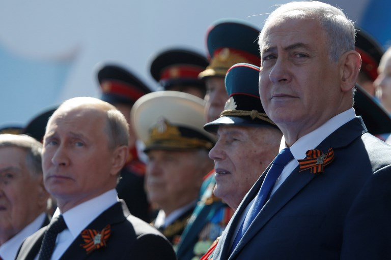 Photo: Anadolu Agency via AFP/Nataliy Zemboska