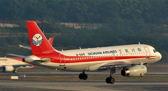 The Sichuan Airlines plane with a shattered windshield touches down at Chengdu Airport on Monday morning. Photo: Handout