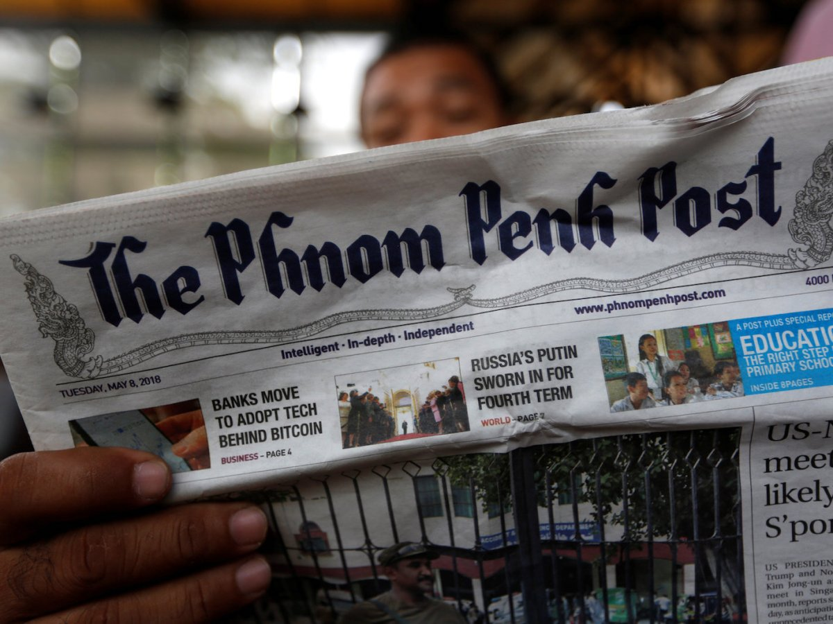 A man reads the Phnom Penh Post at a coffee shop in Phnom Penh, Cambodia, on May 8, 2018. Photo: Reuters/Samrang Pring