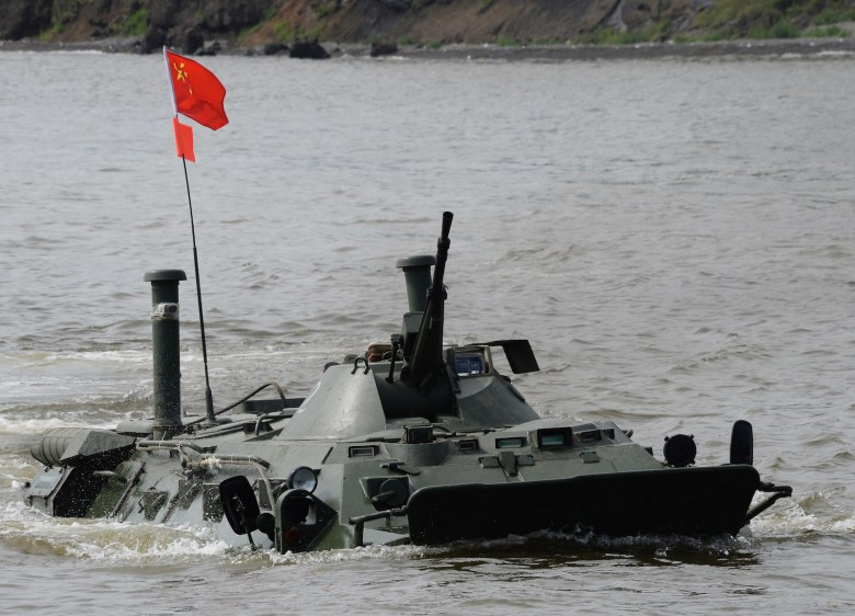 A Chinese amphibious assault vehicle in the Seaborne Assault 2017 international competition held at Klerk training area of the Pacific Fleet. Photo: Sputnik via AFP/Vitaliy Ankov